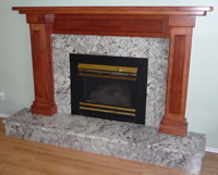 elegant fireplace with granite tiles
